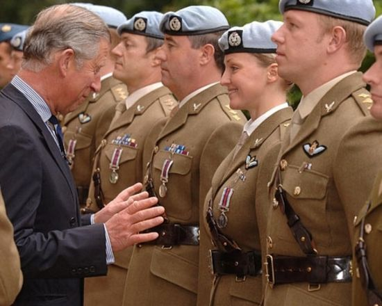 prince charles caught grabbing soldier