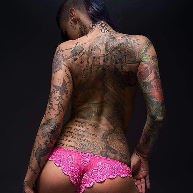 Full Back and Sleeve Tattooed Woman