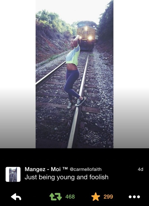 girl standing on train track