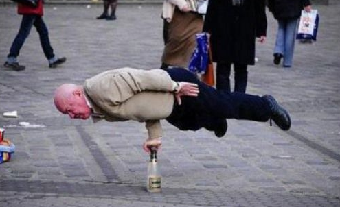 epic old man balancing on a glass bottle