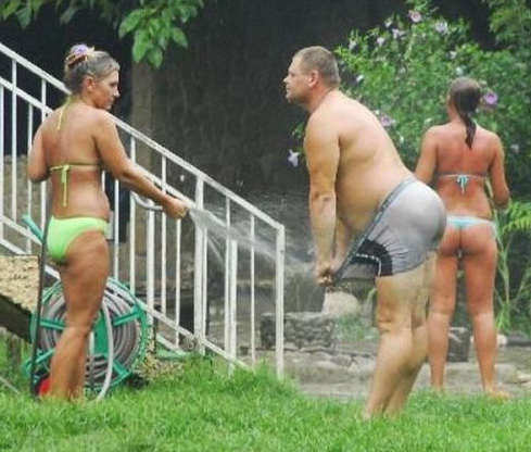 hosed down by woman in bikini