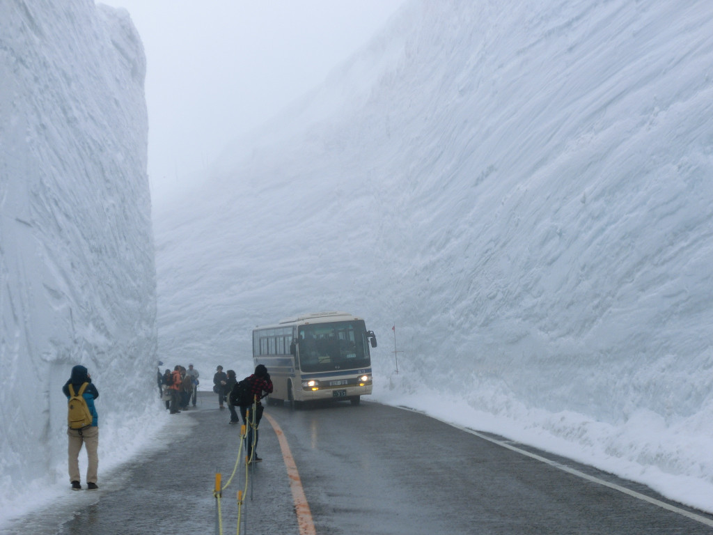 bus travels through snow drift in japan
