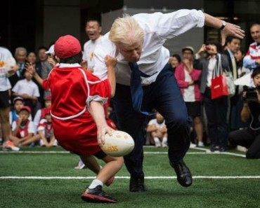 Scrum Down For Boris Johnson Watch Him Take Out An Unlucky 10-Year Old Japanese Boy